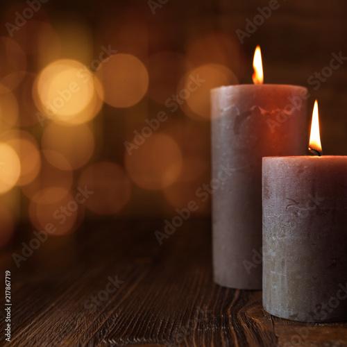 Leinwanddruck Bild Burning candles and golden lights