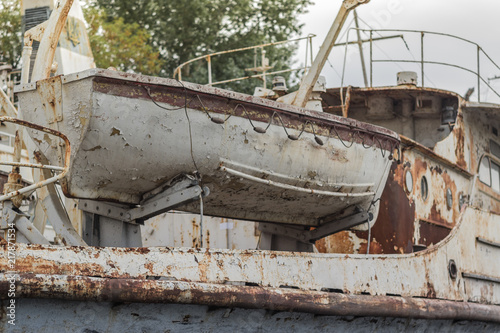 Rusty weathered old white fishing boat in the harbor on the Dnieper River, Ukraine
