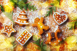 Cute Christmas flat lay with ginger bread man and bokeh lights on wood