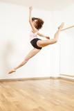 Young beautiful female  ballett dancer posing in studio - 217883501