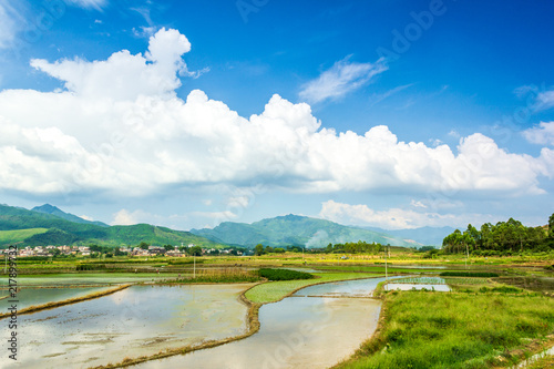 Fotobehang Pool Pastoral villages under blue sky and white clouds