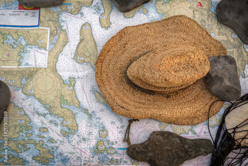 Sea Charts and Hat Held Down by Rocks