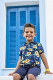 Portrait of a cute little boy on a village of an island greek