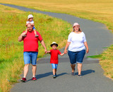 Overweight family walking on footpath. Hiking is outdoor sport for all. Summer vacations on countryside.  - 217911103