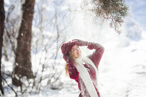 Foto Murales Young beautiful woman having fun in winter time outdoors
