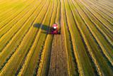 Combine harvester at work - 217946344