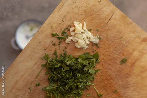 Fridge magnet chopped herbs and garlic on cutting board