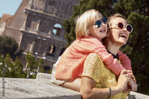 mother and child tourists in Rome, Italy having fun time