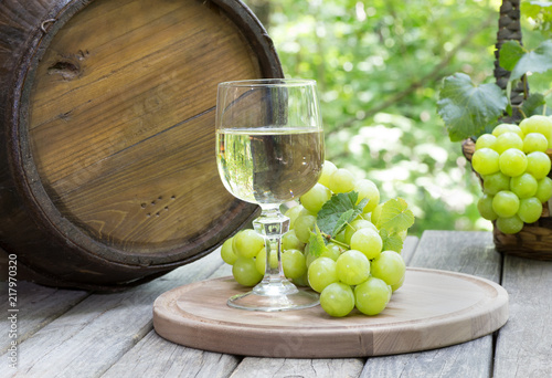 Outdoor Setting of a Glass of Wine and Green Grapes