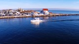 Boats entering in and out of Galilee port in Narragansett - 217974977