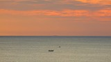 South china sea tropical sunrise orange sky scenery with fishing boats, ocean waves, orange red cloudscape sky, central Vietnam. Panning panoramic scenery. - 217976561