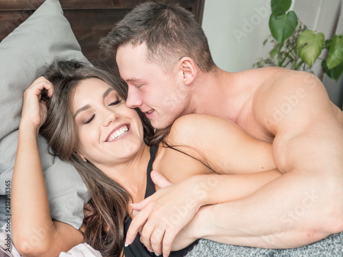 close up of couple romancing in bed buy photos ap images