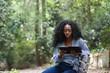 Upset black woman reading sorrowful book