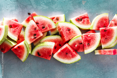 Watermelon slice stone blue background top view - 217998154