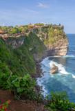 Pura Luhur Uluwatu temple. Stone cliffs, ocean waves and ocean landscape. Bali island, Indonesia.