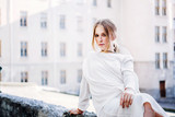 Woman in white vintage dress sitting outdoor - 218021968