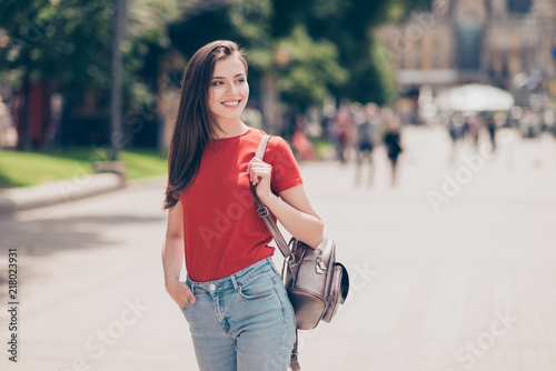 Nice charming attractive cute young cheerful smiling girl outdoo