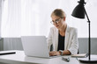 Leinwanddruck Bild - portrait of businesswoman working on laptop at workplace in office