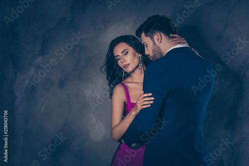 Leinwanddruck Bild Portrait of tempting brunette lady with close eyes enjoying gent