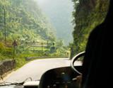 Bus ride on Prithvi Highway between Kathmandu and Pokhara in Nepal - 218045787