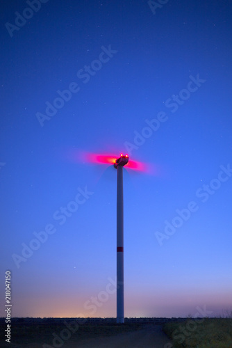 Aluminium UFO view to red lights on the wind generator in blue evening