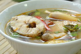 spicy boiled snake head fish and straw mushroom in tom yum soup on bowl