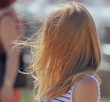 Long hair on a girl's head in the wind