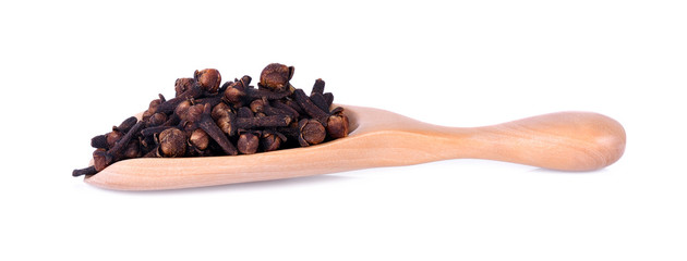 spicy dried clove, syzygium aromaticum flower buds in wooden spoon. © SIRICHAYAPAT