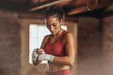 Female boxer wearing strap on wrist - 218067531