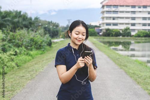 Wall mural Women play phone when exercising.