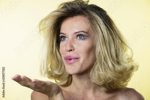 Plexiglas Kapsalon cute stylish blonde girl on bright background