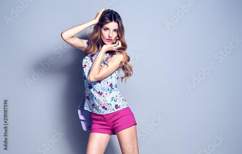 c596c348e Gorgeous long-haired Blonde woman wearing Stylish blouse and fashion Pink  shorts. Beautiful sexy