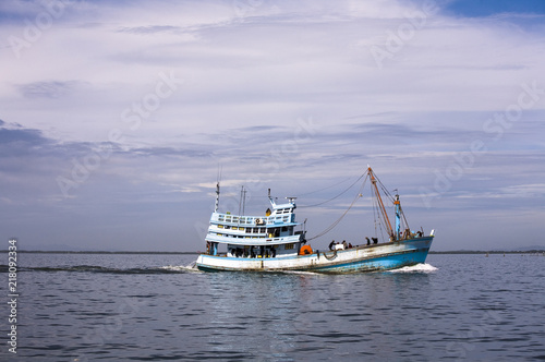 Fishing boat in a clam beautiful sea in gulf of Thailand.