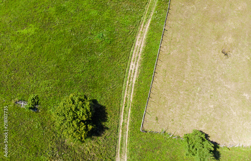road and green meadow. aerial view