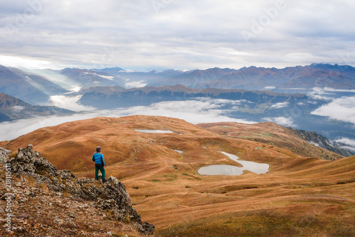 Tourist near a mountain lake - 218115511