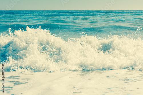 Vintage style image of waves crashing in the deep blue Mediterranean sea - 218130997