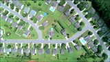 Overhead view of a small, suburban neighborhood. - 218145574
