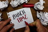 Handwriting text Lunch Time. Concept meaning Meal in the middle of the day after breakfast and before dinner Man holding marker notebook page crumpled papers several tries mistakes. - 218184326