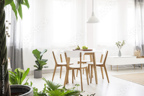 Real Photo Of A Bright Scandi Dining Room With White Lamp Above Round