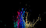 Abstract sculptures of colorful splashes of paint. Dancing liquid on a black background. Ink water splash. Color explosion. - 218200367