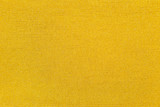 Gold color cotton knitted textile as background