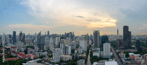 panoramic view of urban cityscape on blue and cloud background - 218221367