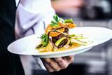Modern food stylist decorating meal for presentation in restaurant. Closeup of food stylish. Restaurant serving - 218231188