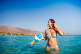 Summer portrait of woman preparing for scubadiving, snorkeling with mask and underwater gear. Swimming, ocean and sea concept