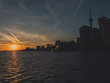 toronto with cn tower during sunset over lake ontario seen from toronto island ferry