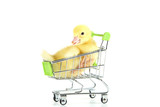 Little yellow duckling in shopping cart on white background - 218261369