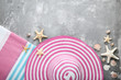 Summer accessories with seashells on grey wooden table