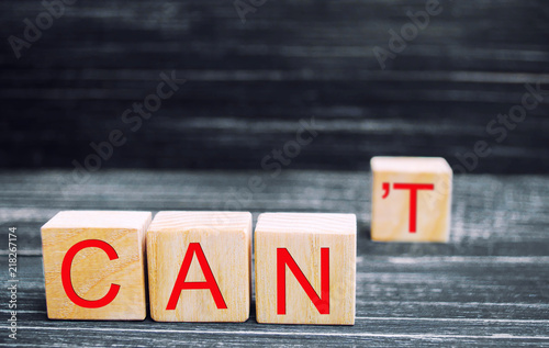 Fototapeta I can self motivation - cutting the letter t of the written word I can't so it says I can, goal achievement, potential, overcoming