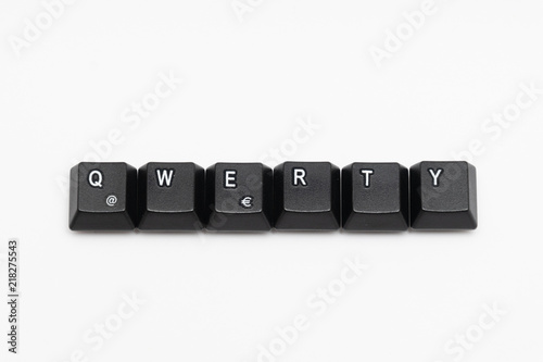 Single black keys of keyboard with different letters QWERTY