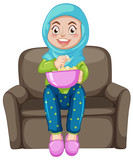 A muslim girl eating popcorn - 218317165
